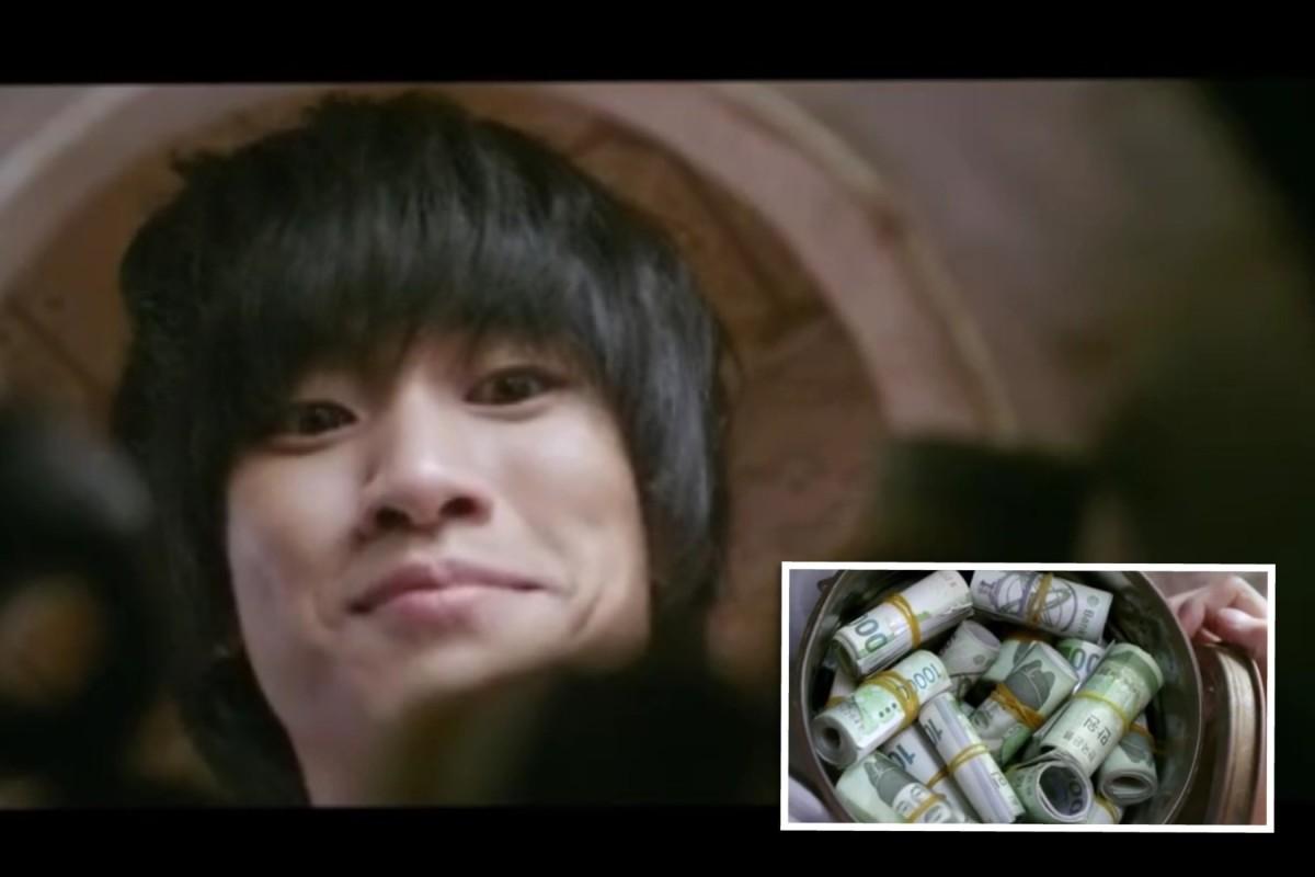 Lieutenant Won Ryu Hwan/ Bang Dong Gu looking at his savings, anticipating he'll be rich when he goes home to North Korea.
