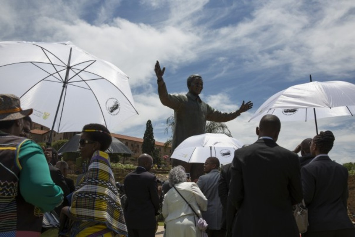 A statue of former South African president Nelson Mandela is unveiled at the Union Buildings in Pretoria on Dec. 16.