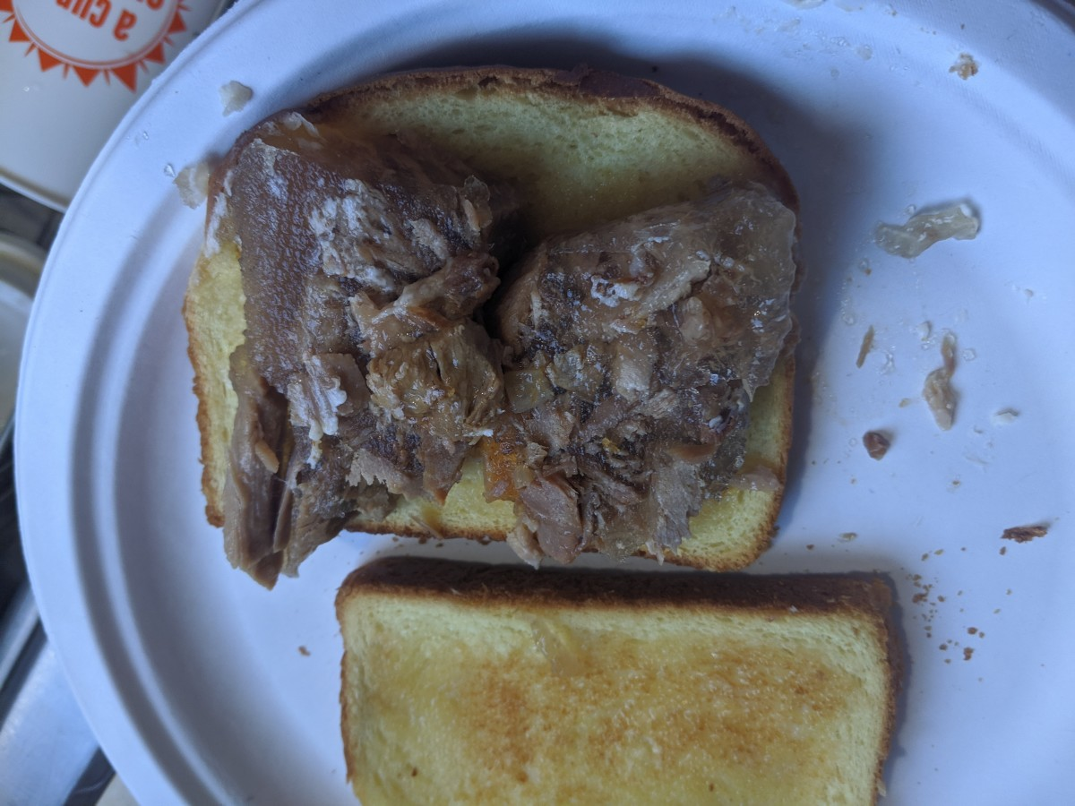 Place slice of head cheese on toast. Cover, and slice as desired. I like mine in fourths.