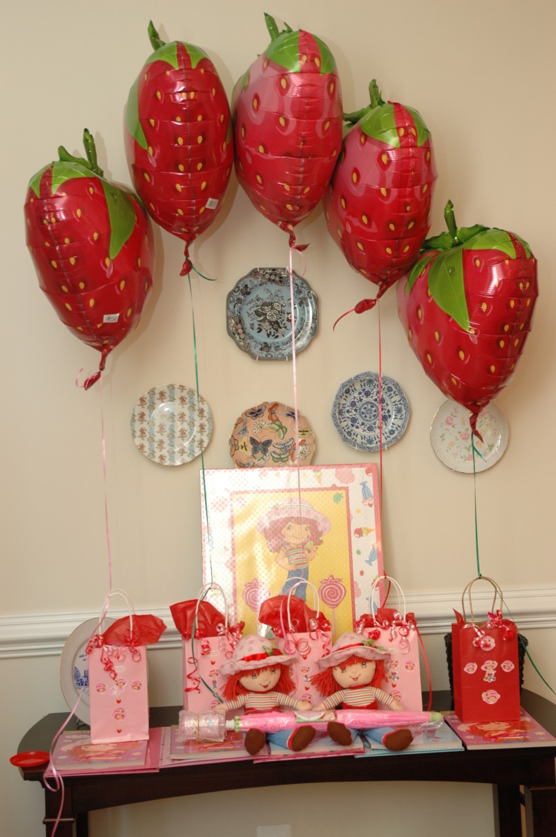 Mylar strawberry balloons and goodie bags.