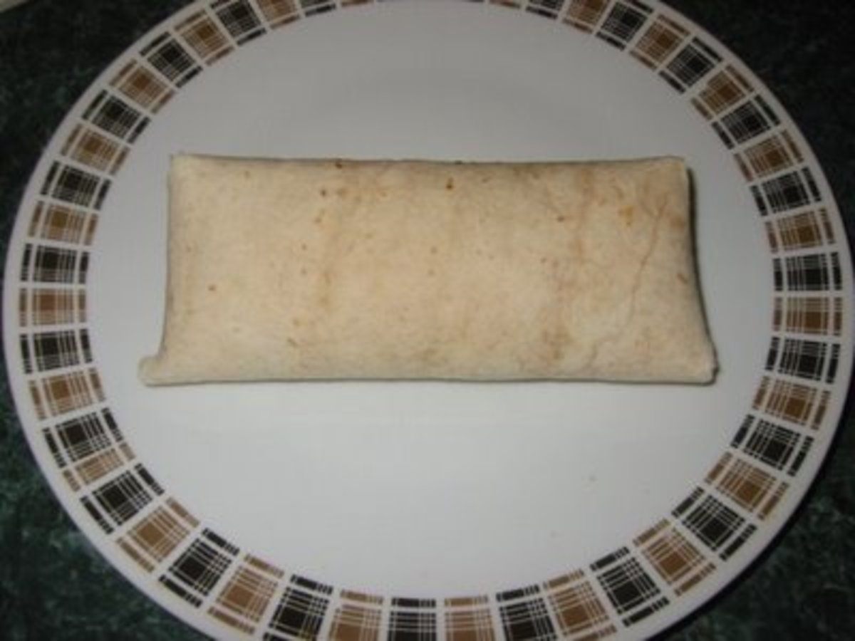 Fold your top flap down and turn your chimichanga over to hold the flaps in. Let them rest this way on a tray in the refrigerator 45 minutes before you deep fry them.