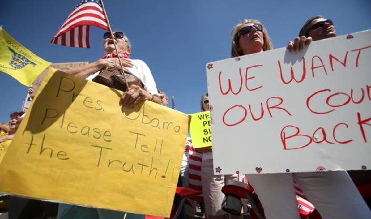 Just because Obama is President, now the  Tea bagger 'want their country back... as their signs depict..