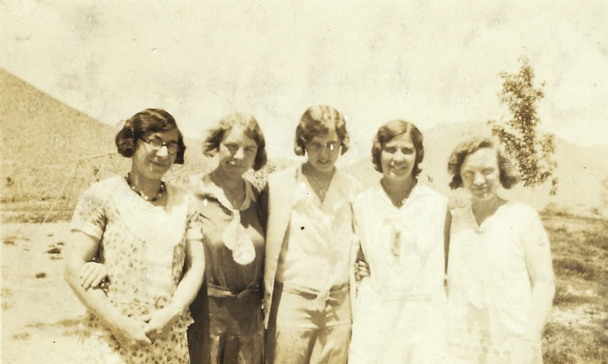 Bertha McGhee is the one in the dark dress with the sailor tie. I see a little plaid pattern in that dress. I'm not sure which names go to which teachers in this photo yet.