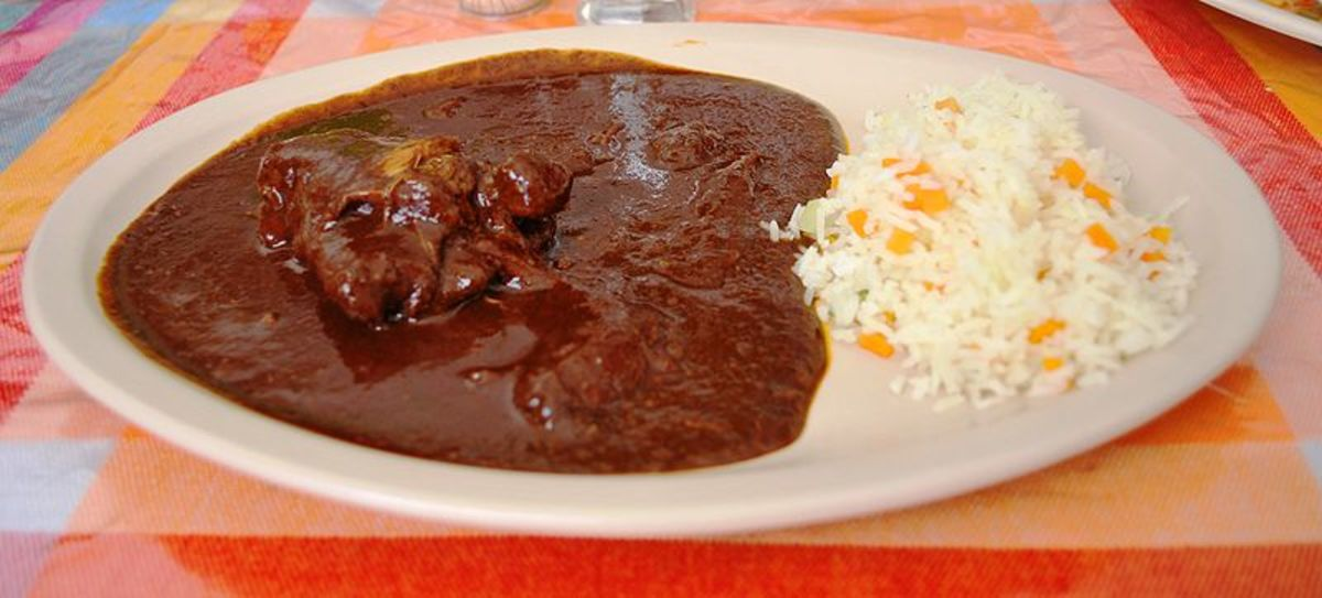 Mole. Note that mole is a sauce with meat in it. it is usually served on a plate with rice and tortillas.