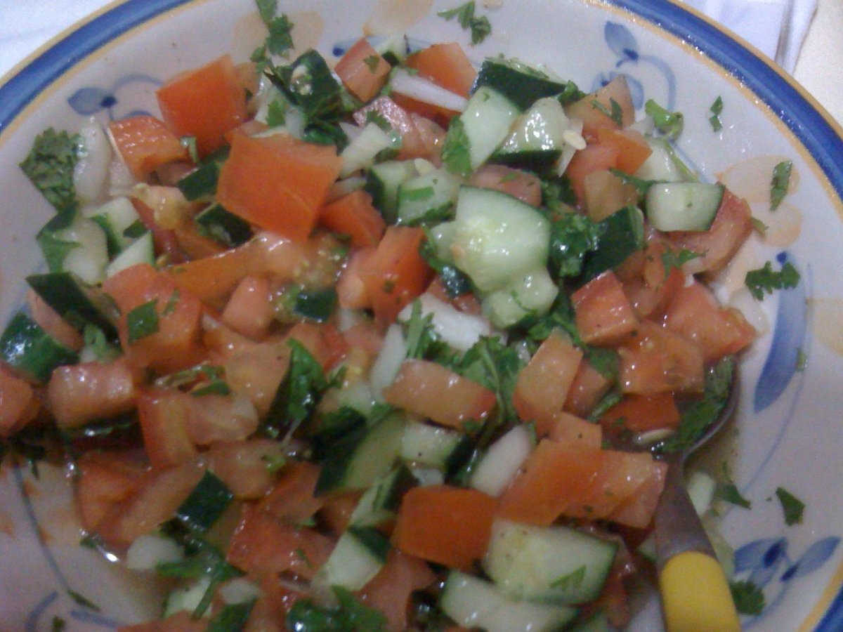 Lime juice provides flavor for accomaniments like this salad which contrasts with bland tasting foods like beans and rice.