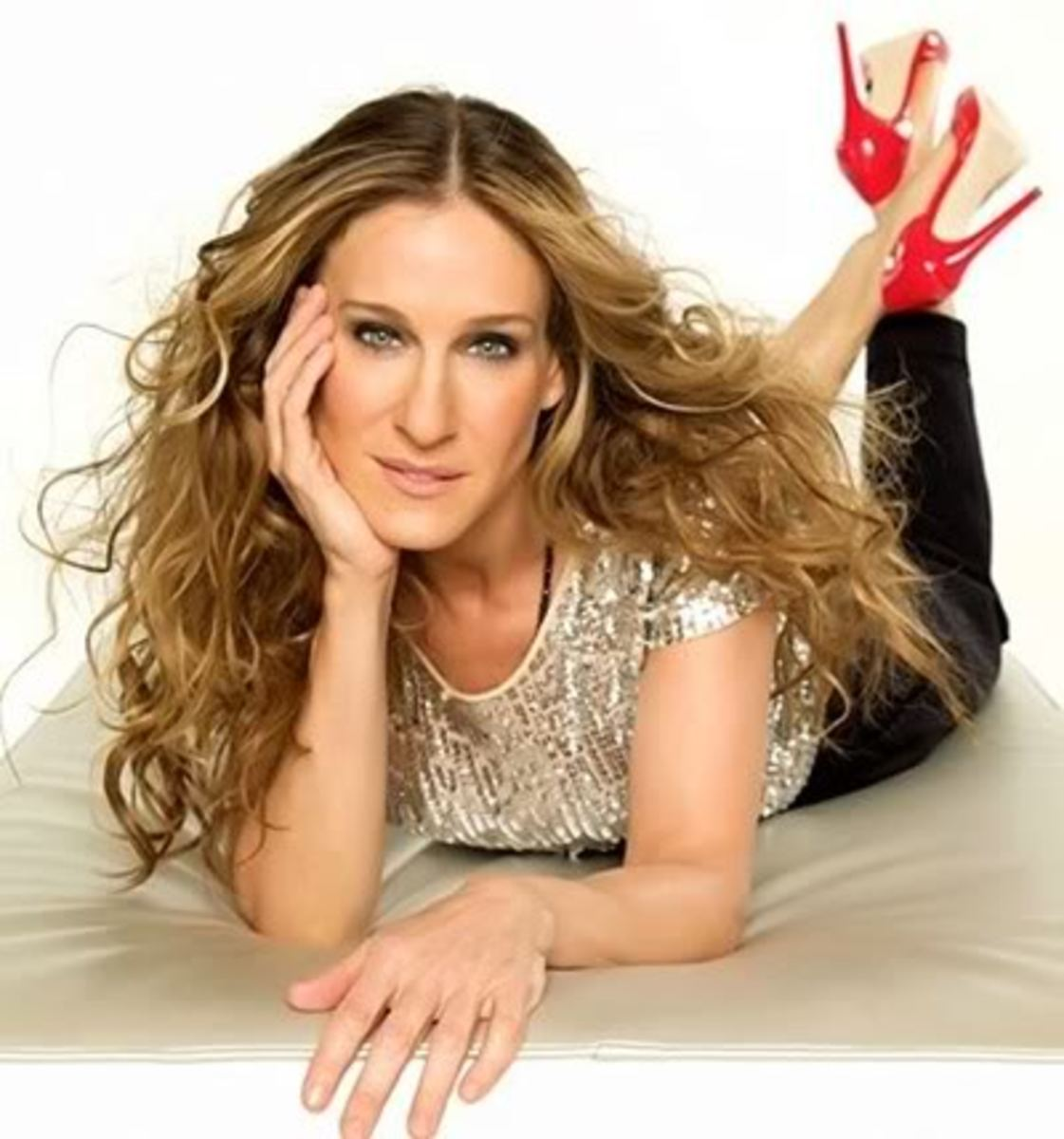 Sarah Jessica Parker long curly hair.