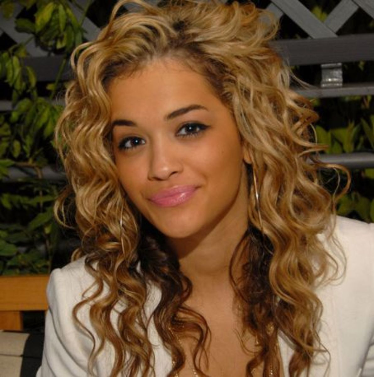 Rita Ora long curly hairstyle.