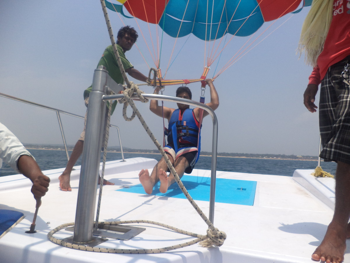 Water sports activities, paragliding on the Goan sea.