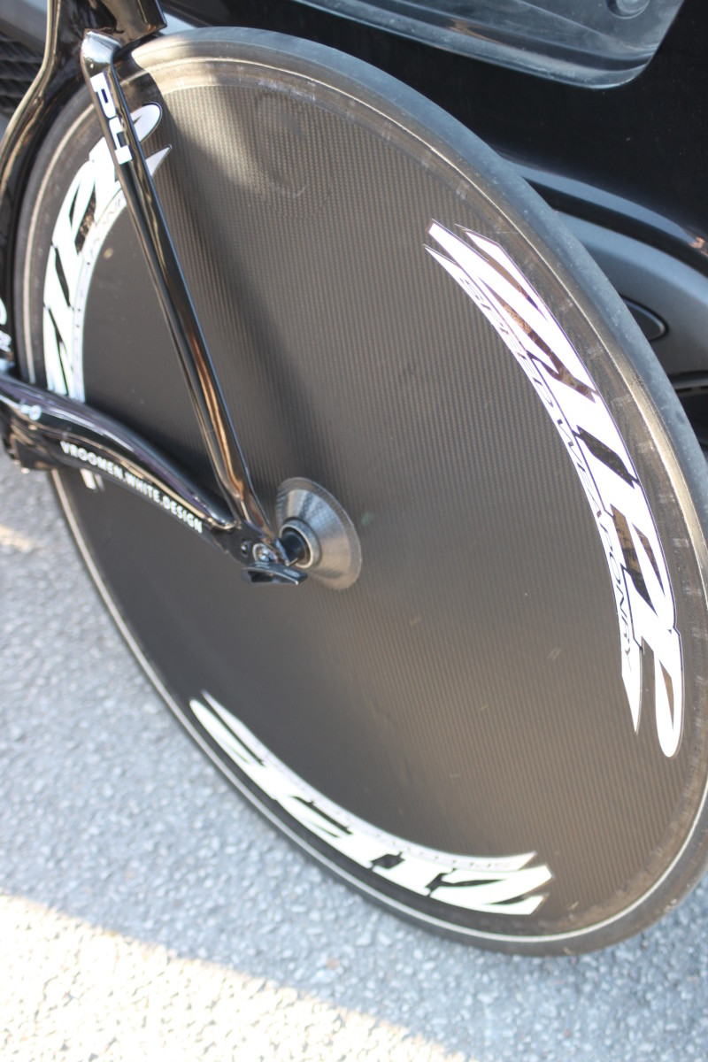 A disc wheel doesn't use spokes. A layer of carbon provides the link for an aerodynamic advantage. Pictured is a carbon disc wheel marked as a Zipp disc. I'll offer a cash prize to anyone who can tell me what disc wheel this actually is.