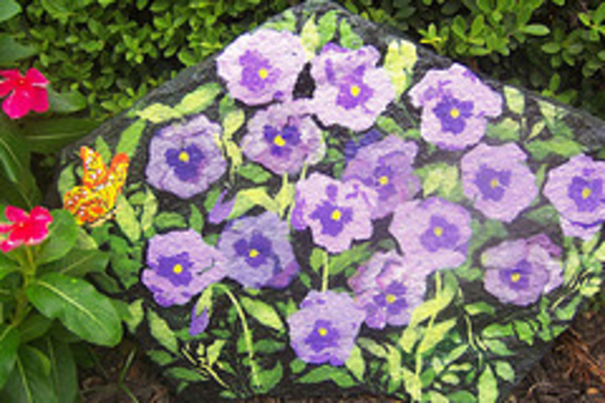 This is a picture of my pansy rock on which I used a stencil to give me a base outline