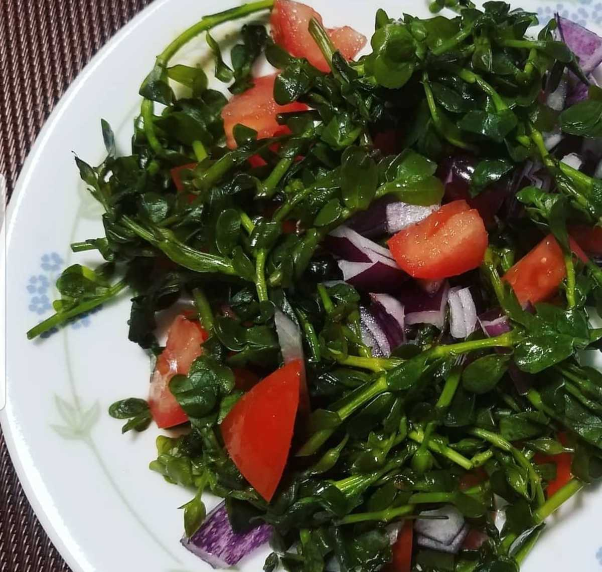Steamed bacopa monniere with tomatoes. Chopped ginger and onions can be added too. And either your choice of soy sauce, lemon or fish sauce whichever you prefer.