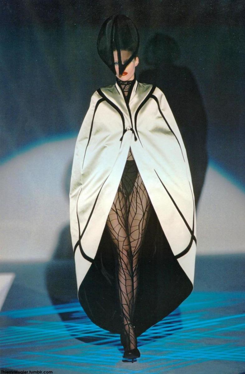 """Runway bold, you'd better own the runway or at least walk like you do. My Spidey Sense tells me this is a no-go. The hat looks like bug eyes, the legs are very insex-ual and the best part of the outfit. The cape / wings sway me from """"Mama to Mothra"""""""