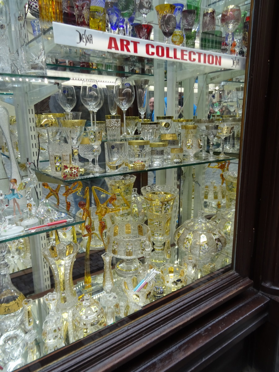 Glass merchants are everywhere, crystal and blown glass. Shoe shops are prominent, simliar to many European cities