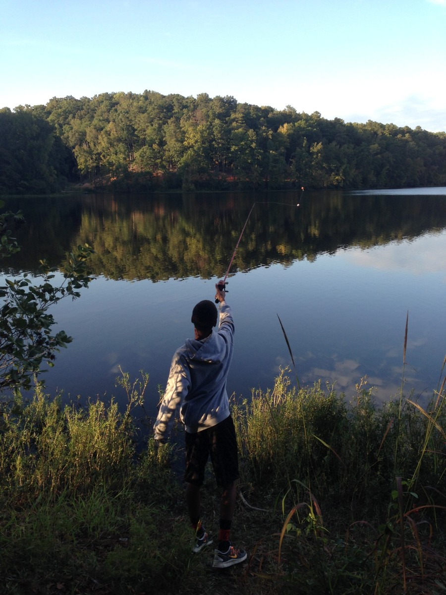 Casting a line while camping at Oak Mountain State Park.
