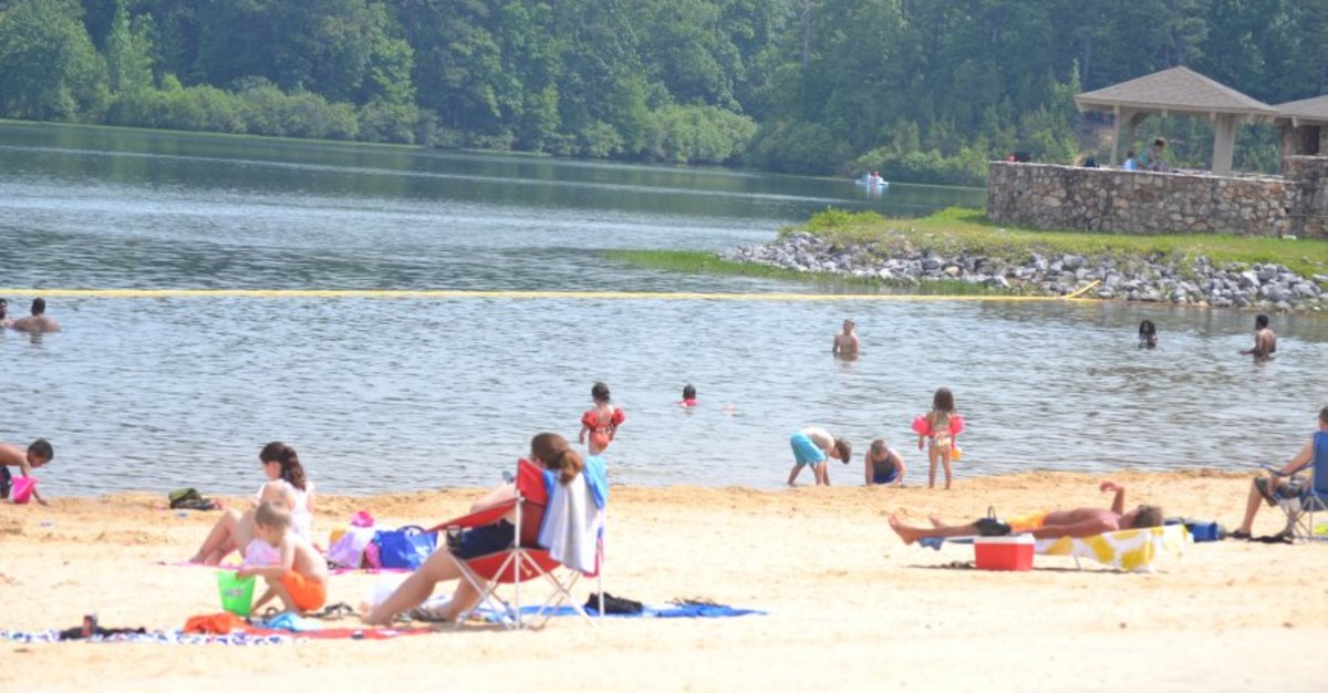 Visitors relax at Double Oak Lake at Oak Mountain State Park