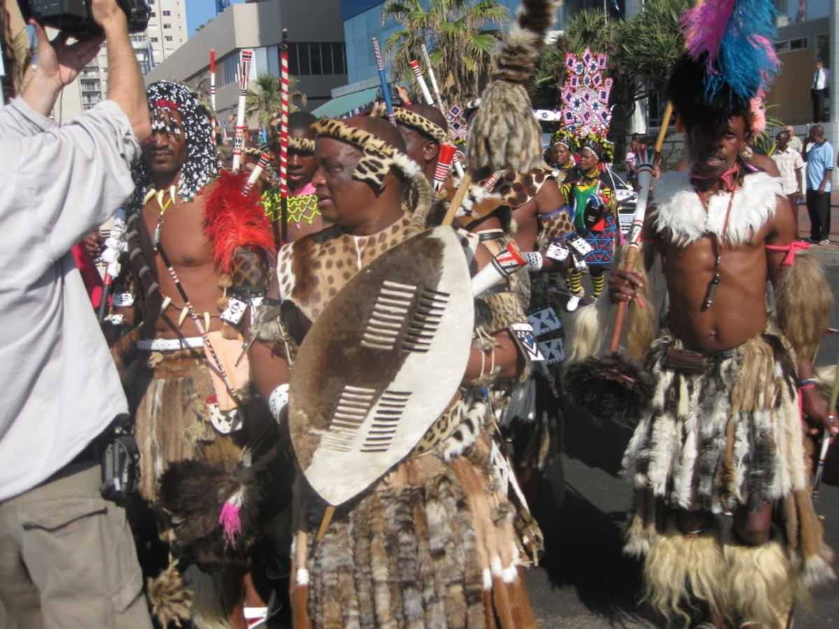Full traditional Zulu customary garb, dancing and singing
