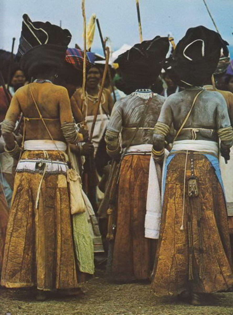 Thembu women(Of the Xhosa People) wore highly decorated leather purses hanging from the hip over leather skirts.Circa 1960
