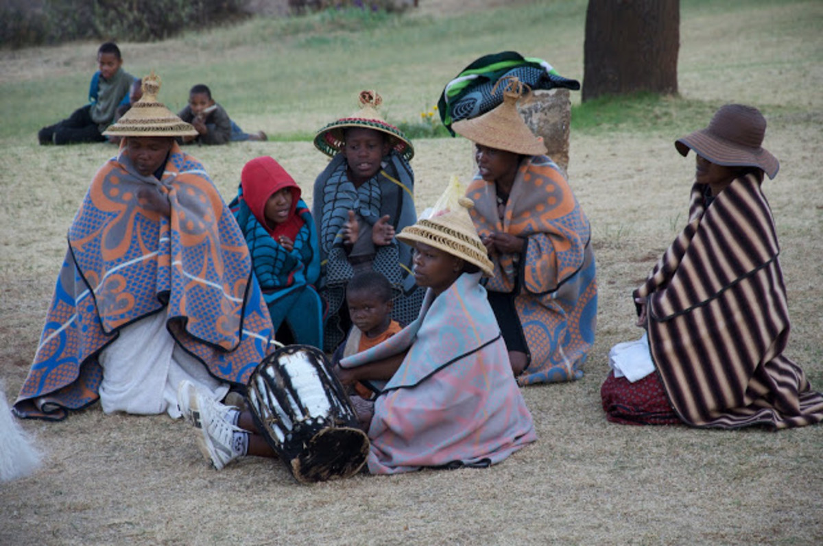 Baotho people coveed in their traditional blanet and waring their customary traditional hats-The dress so because they live in the Maluti(Mountains of Drakensberg where it is very cold