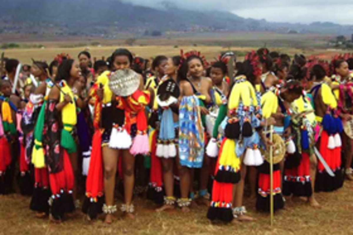 Swazi girls in the festival and celebration of the reeds dressed in their colorful traditional dress