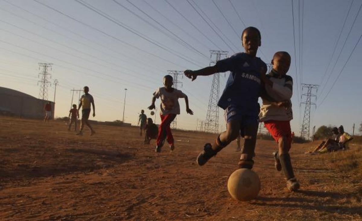 Schildren keeping soccer alive in the dusty streets of the Townships