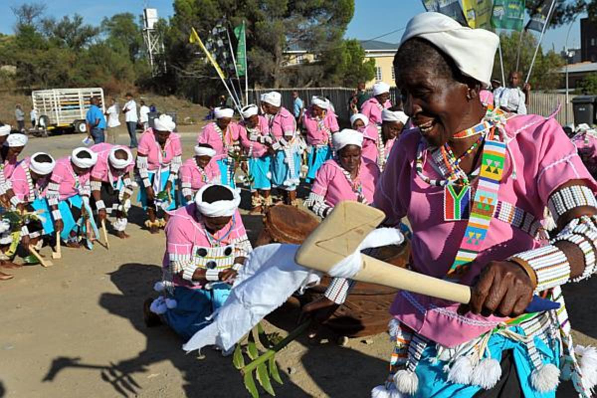 Bapedi women dressed in ceremonial.cultural garb, and performing their sacred rites and practices, through music and dance