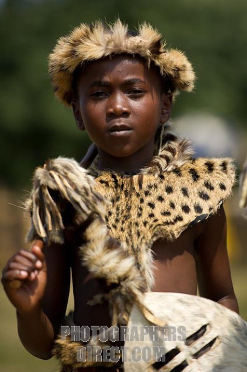 Young Swazi lad clad in cultural garb and a stoic look to go with it...