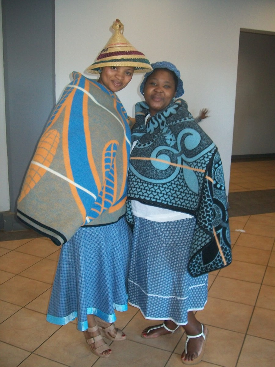 The mix of the New and the Old: Basotho women dressed in their traditional hats, blankets and dresses...