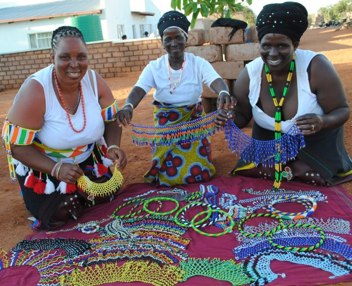 Bapedi women hawking their wares: Embroidered Beads. The Pedi are of Sotho origin. The name Sotho is derived from batho ba baso,meaning dark or black people. All available evidence indicates that the Sotho migrated southwards from the region of the G