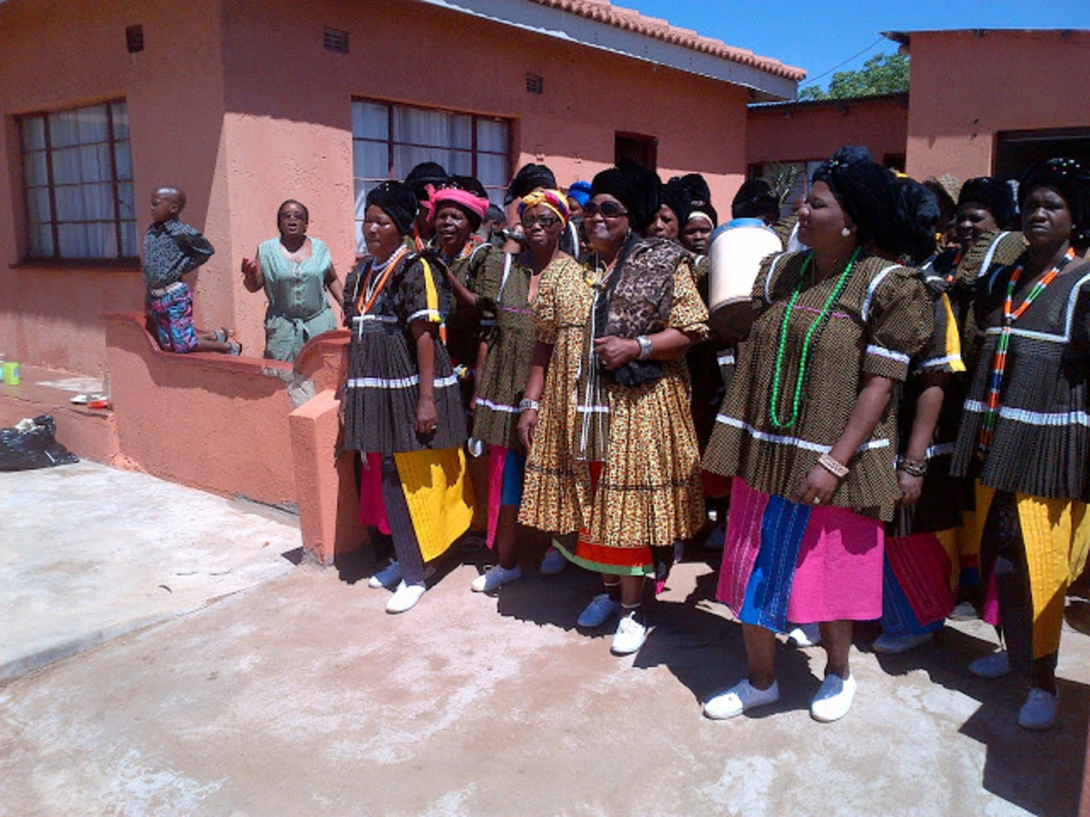 Royal Highness accompanied by her sister in laws, in sepedi 'ke di ngwetshi'-they are married women. They all dressed in the same attire.