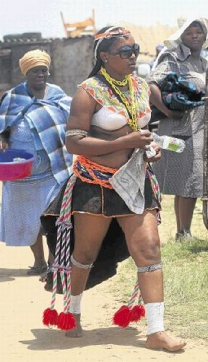 A Mosotho Female Initiate coming home