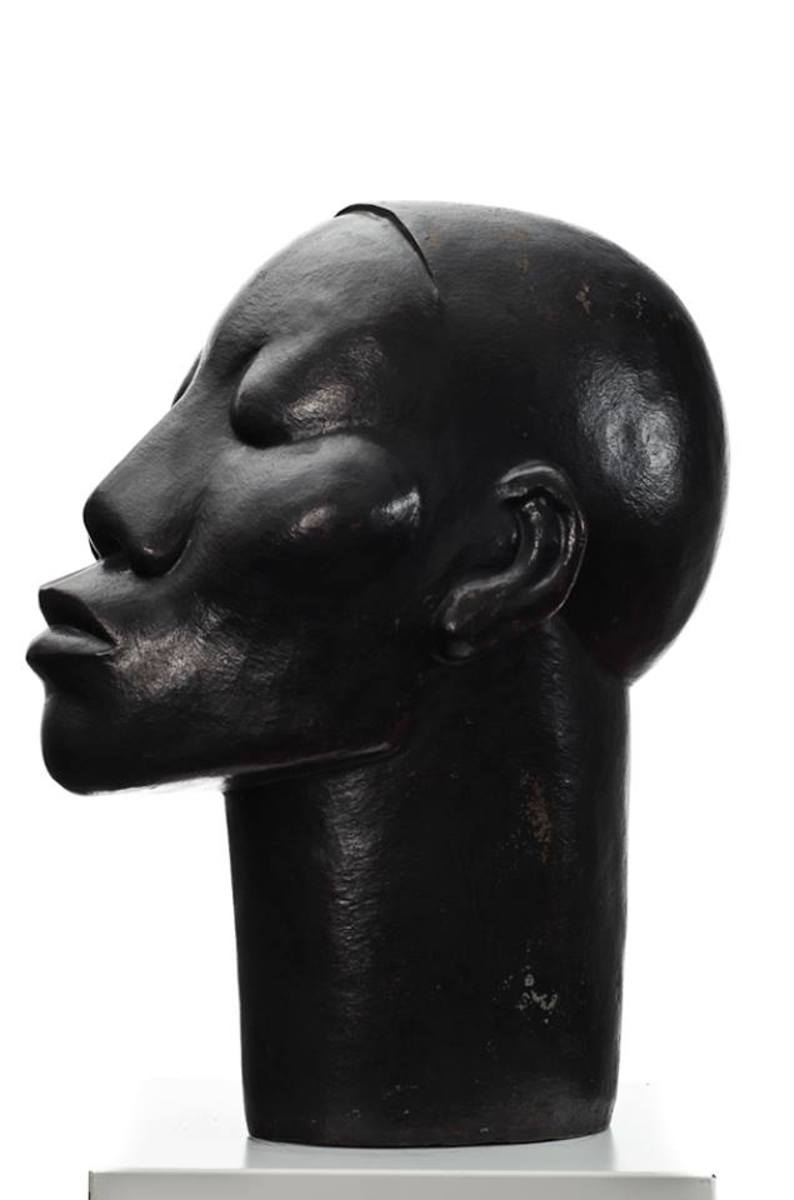 Dumile Feni's sculptures spotlight the difference between white and black in South Africa. Portraits displaying clear characteristics of native Africans remain untitled, and therefore given that name: Untitled. They are depicted as the archetype of t