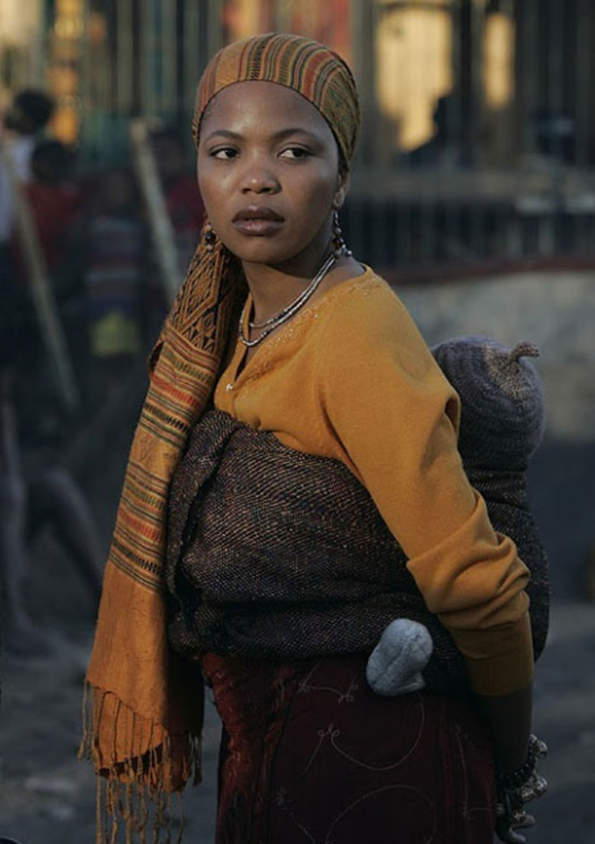 Motswana Woman carrying her baby other back.. Decked in a scarf the Tswana way..