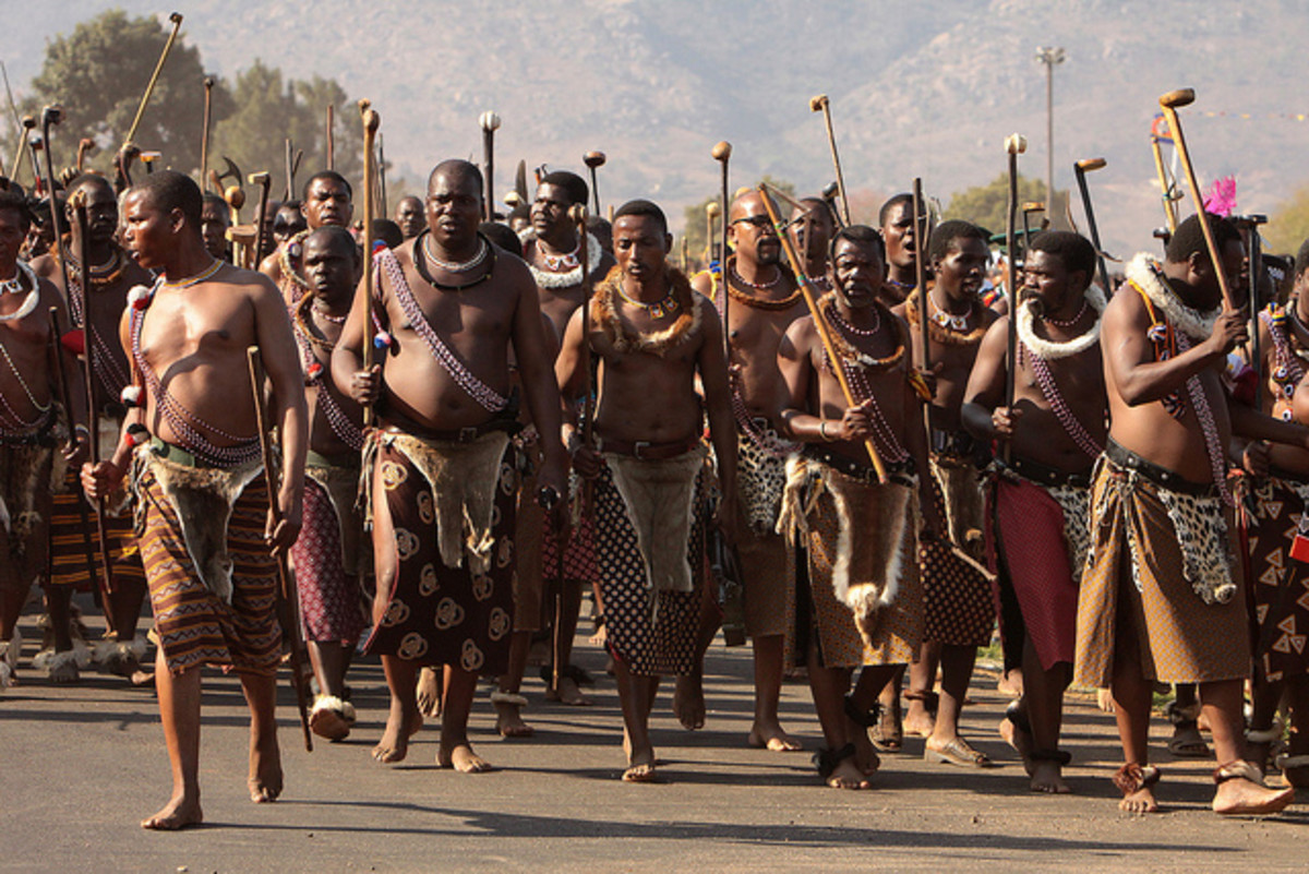 Adorning their cultural gdb and marching in the reed carrying their traditional sticks, The elderly men march on in the Reeds Festivities, bare-footed