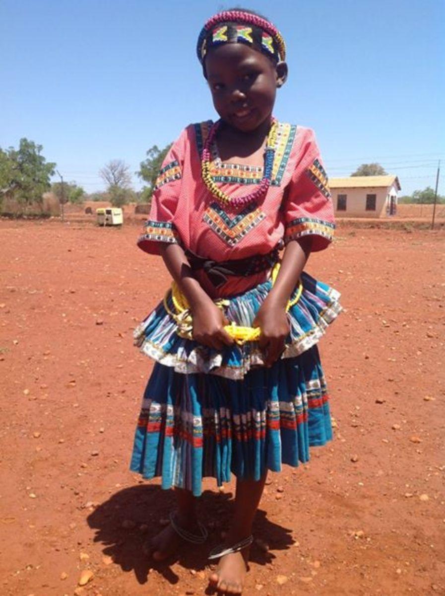 Little Tsonga girl in traditional dress