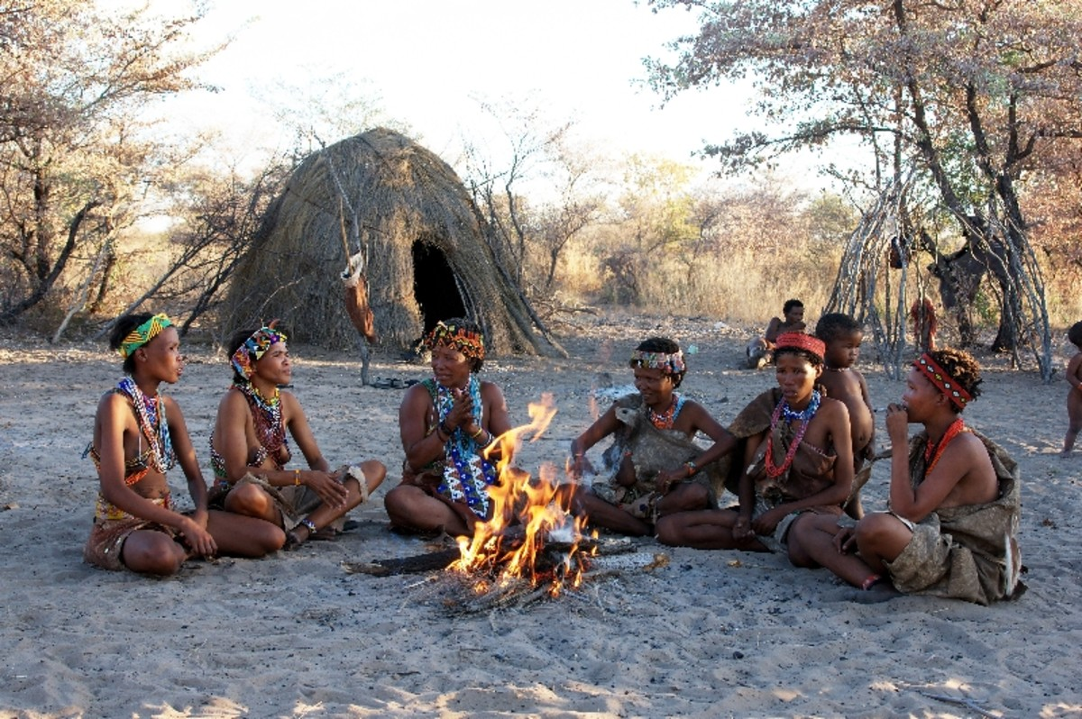 Namibia KhoisSan women sitting around the fire in their village