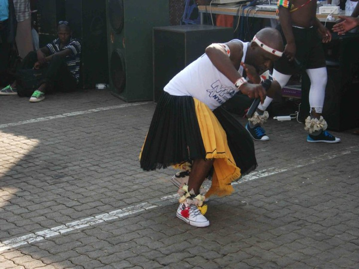 Bapedi Man performing his traditional dance adorned in his customary traditional clothing