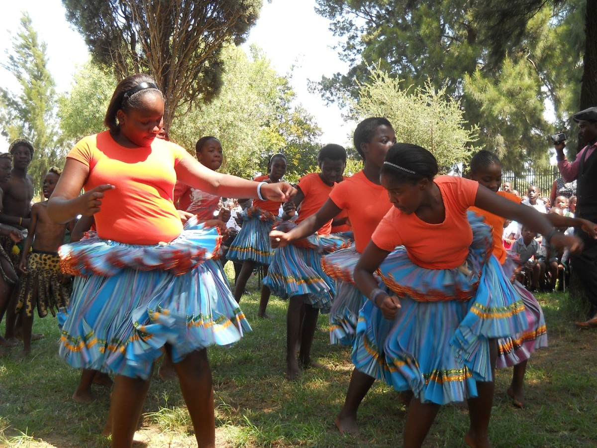 Tonga Lasses Doing Traditional dance in their traditional wear