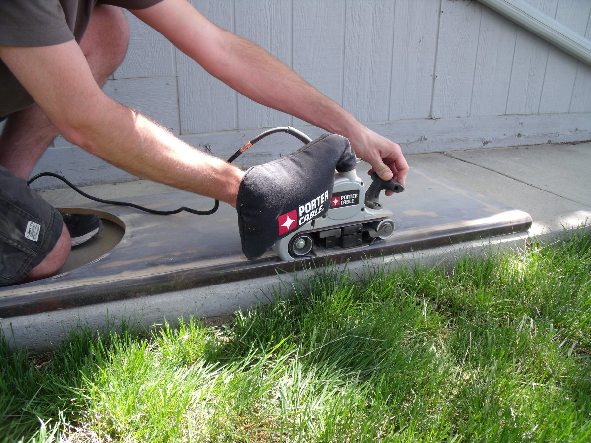 Use a belt sander to roughen the surface of the countertop.