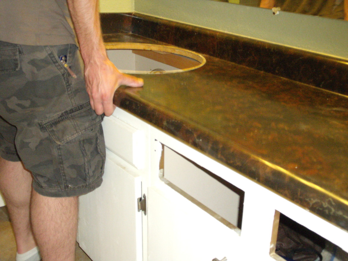 Carefully lift the countertop up and off the cabinets.