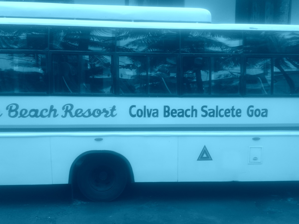 A tourist bus parked in Colmar Beach Resort. They arrange Goa tour every day in the morning.
