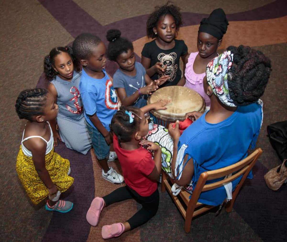 Sis. Omelika Teaches Youth About the Drum at the Atlanta Public Library.