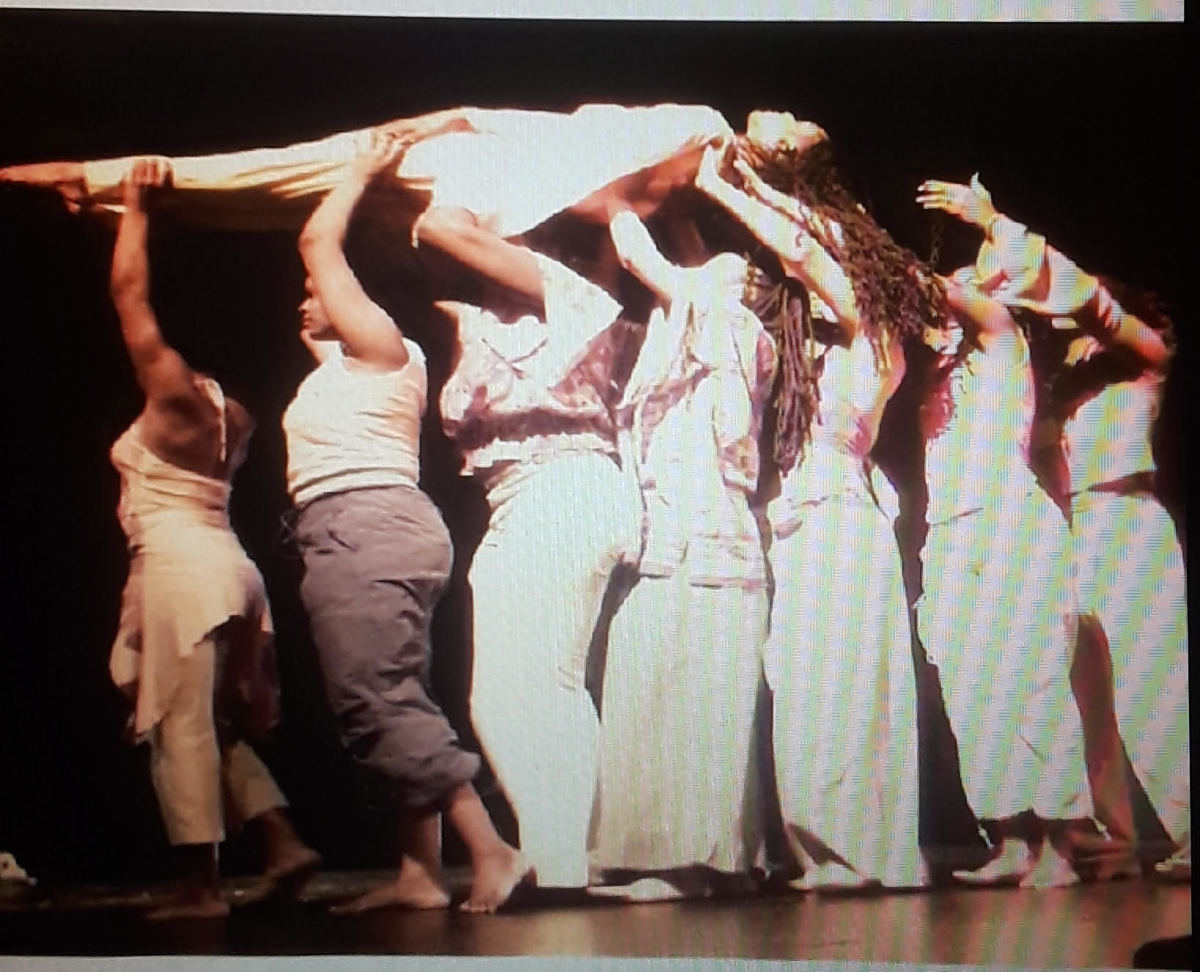 Sis. Omelika being lifted by Giwayen Mata in a piece choreographed by Kwame Ross