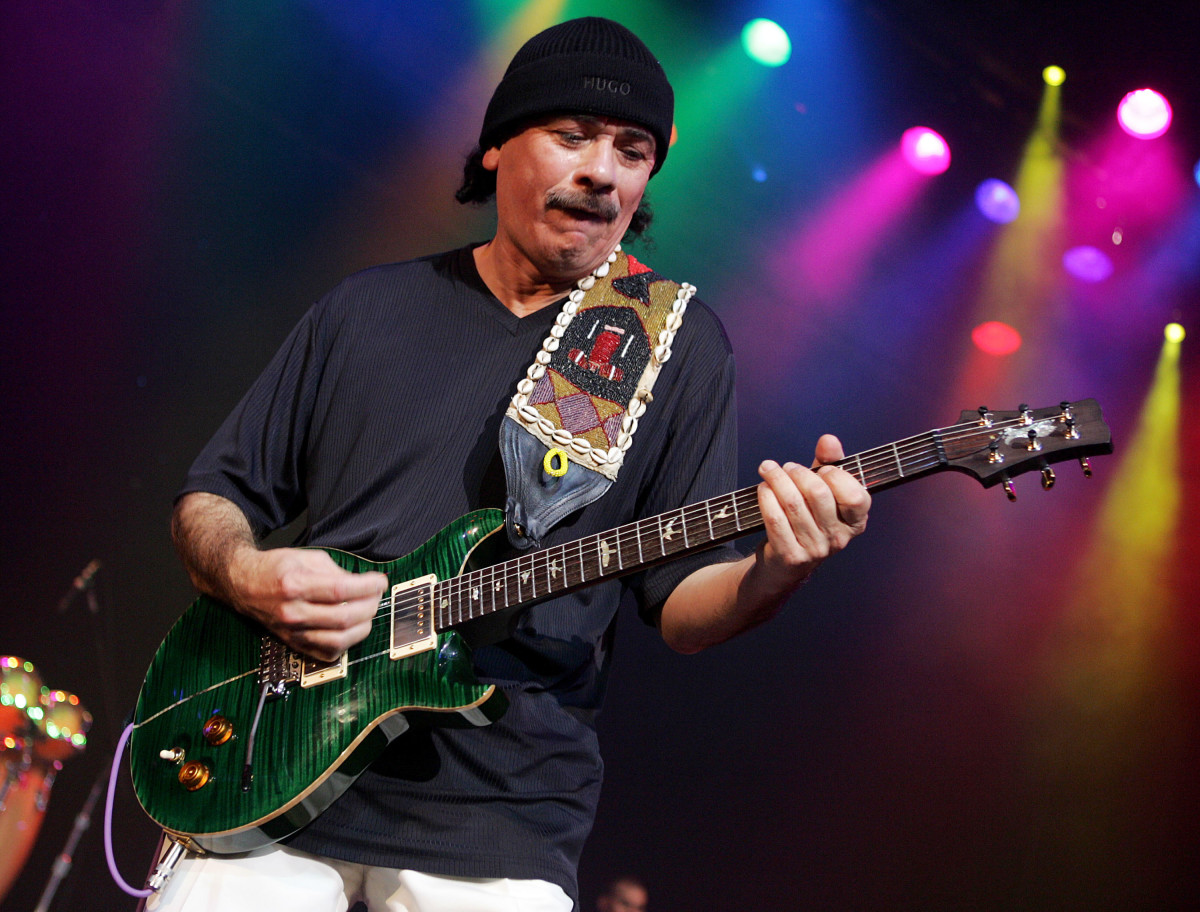 The great Carlos Santana on stage with one of his PRS guitars