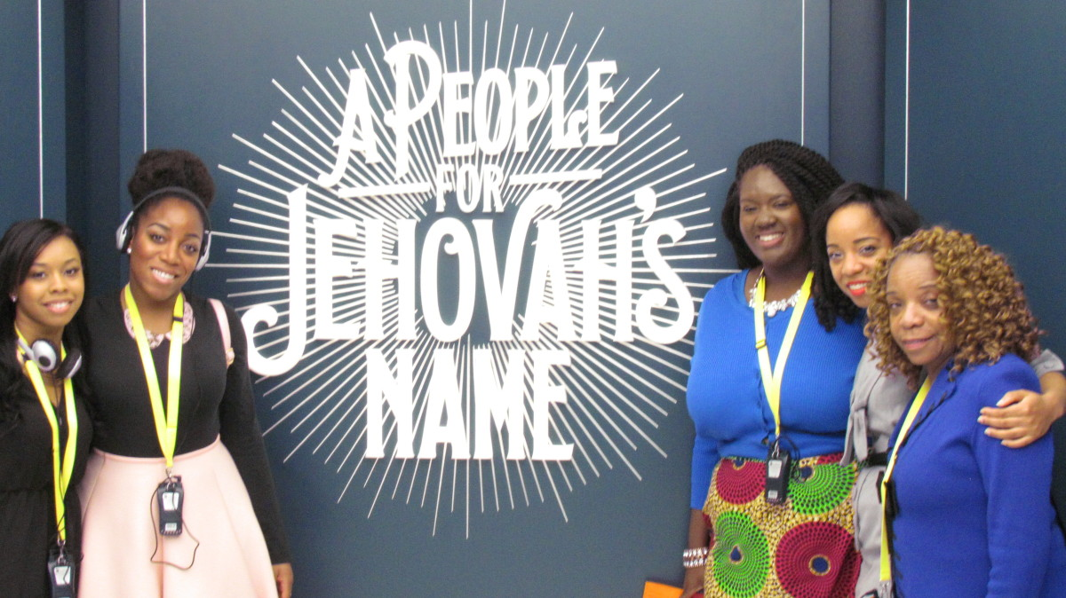 "Starting from the left is Brittany and Wanisha. On the right is Chantal, Jaleesa and Claudette, in front of this powerful message entitled, ""A People for Jehovah's Name."""