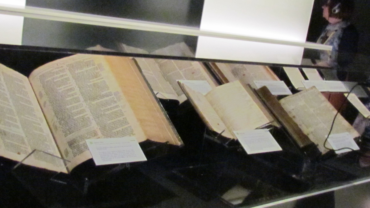 "Various Bibles that are exhibited within the ""Divine Name"" display which includes God's holy name."