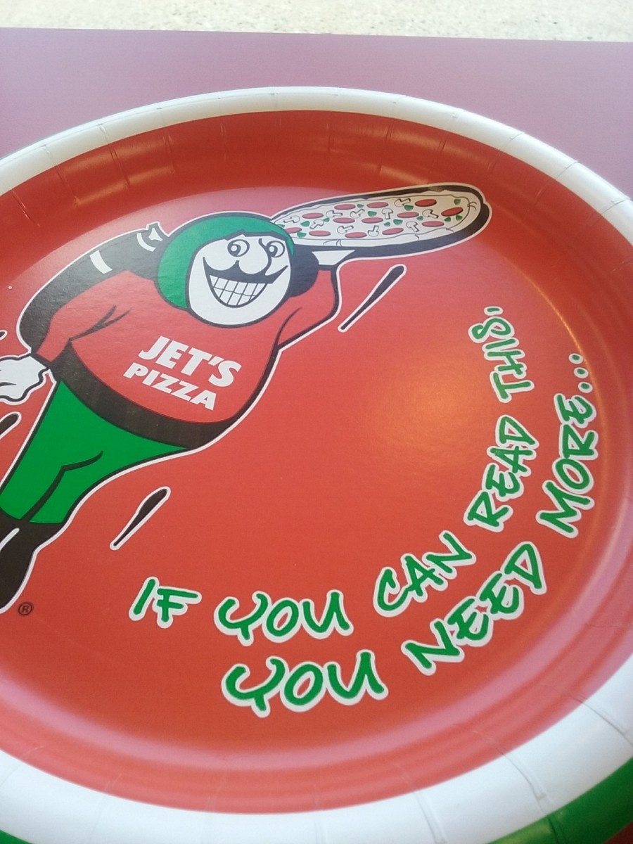 Cute disposable plates are offered at Jet's Pizza restaurant