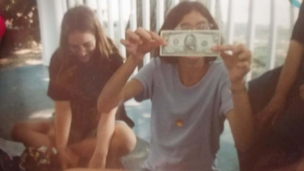 That's me with the money in front of my face, and my best horse crazy friend, Rachel, next to me.