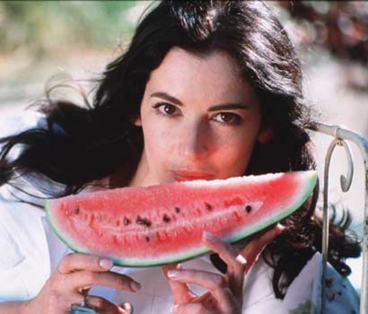 Nigella Lawson doing her thing with a large fruit