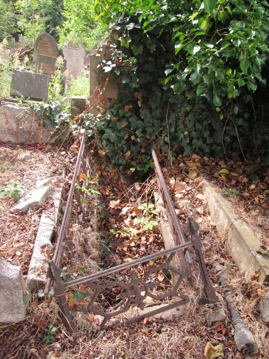 ... The stone memorial lies flat, the iron railings rusted, the top has been removed - it's said at times satanists enter these grounds as well as the City of London Cemetery not far away to the north of Newham
