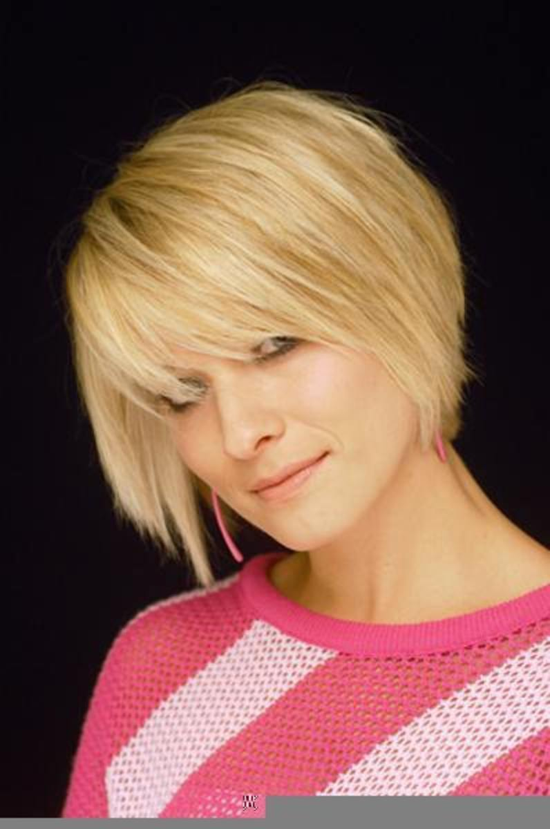 Short bob cut with bangs for thin hair.